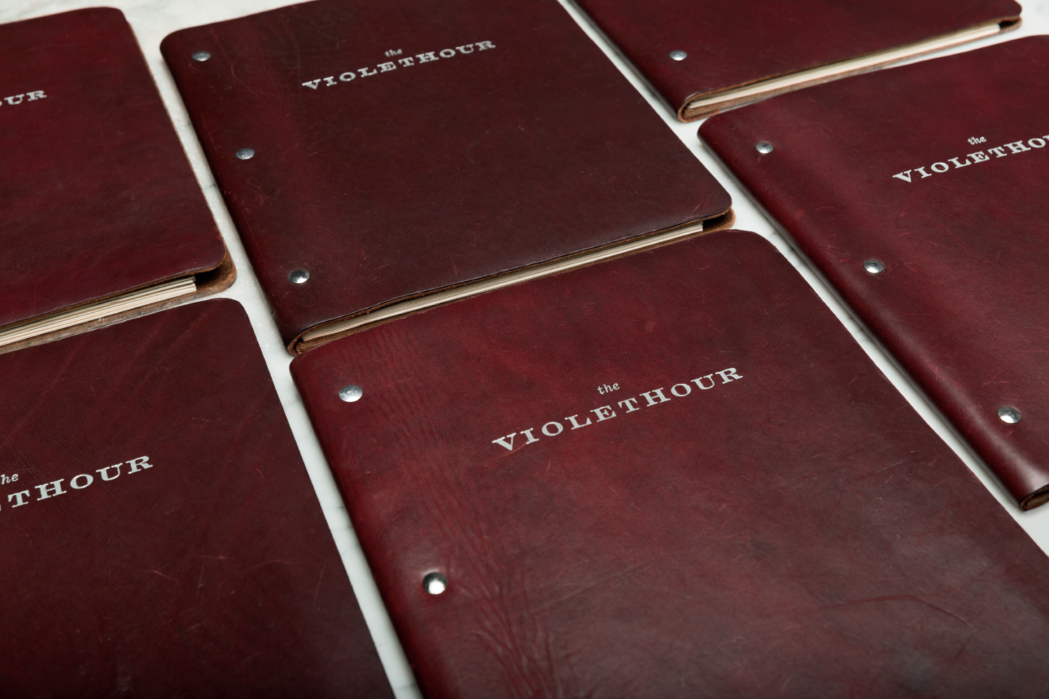 The Violet Hour Chicago graphic design and custom leather menu covers.